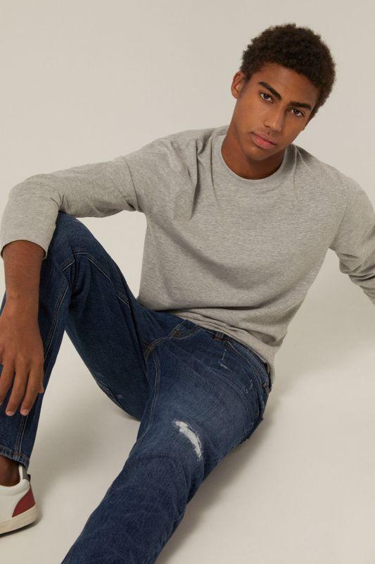 Medium-dark wash slim fit jeans with rips