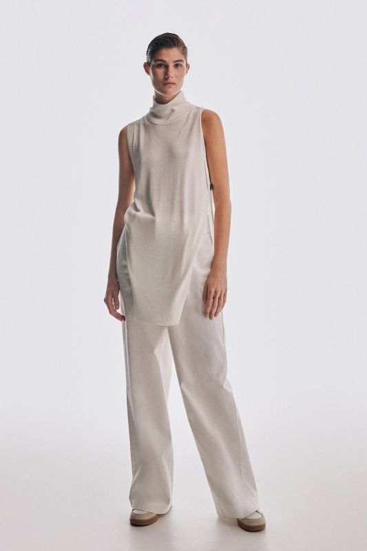 Polo neck knit gilet with side slits