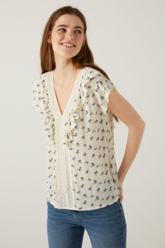 Lace blouse with ruffles.